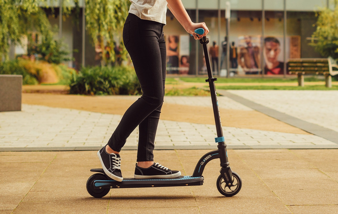 Safe electric scooter for teens and adults with a dual braking system