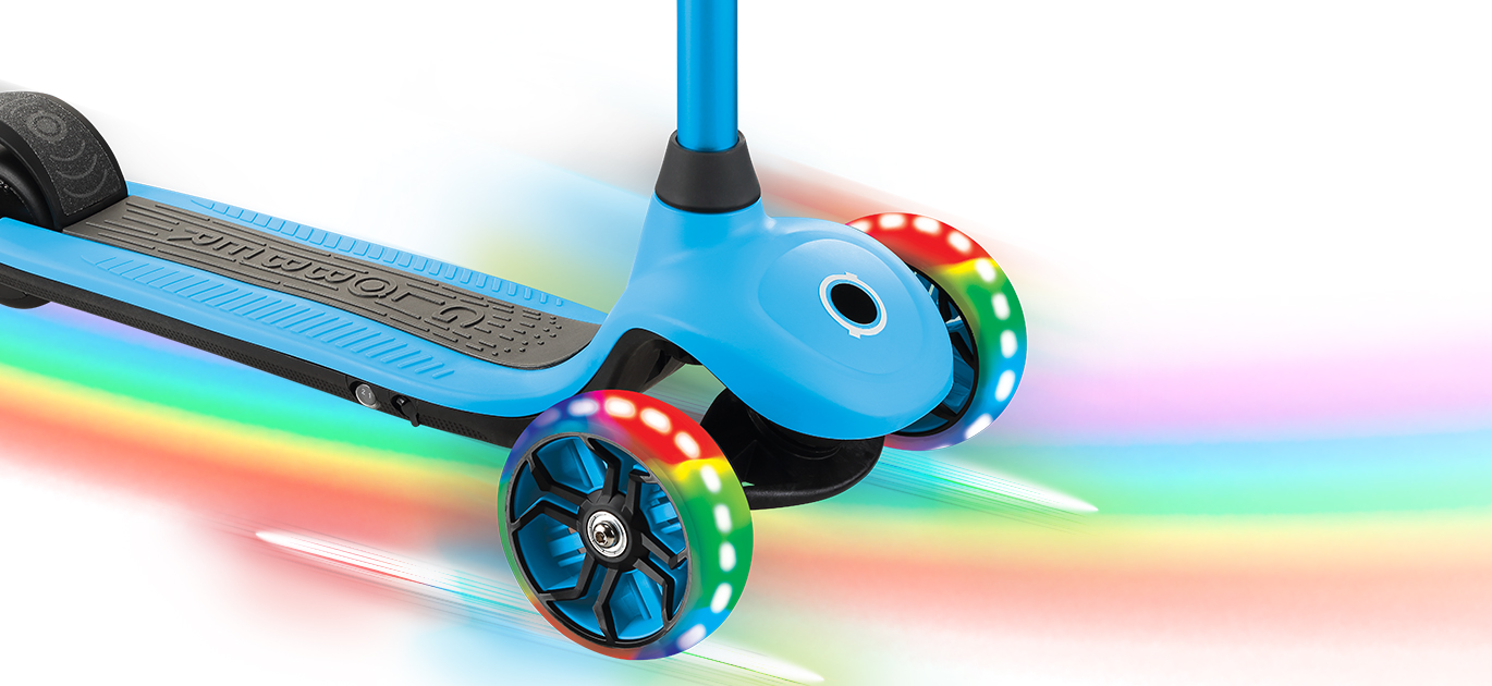ONE K E-MOTION 4 light-up electric scooter wheels flash in red, green and blue.