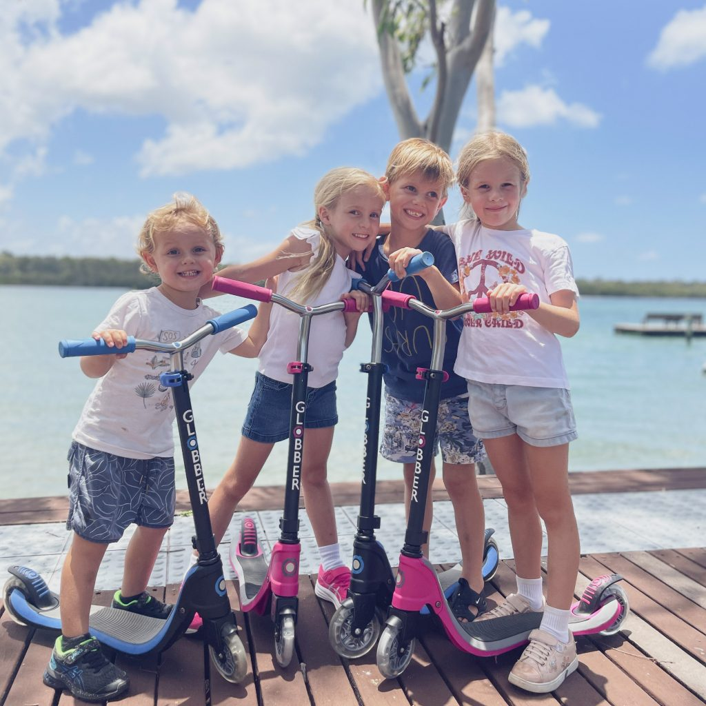 Thumbnail - Globber kid crew with their FLOW series 2-wheel scooters for kids