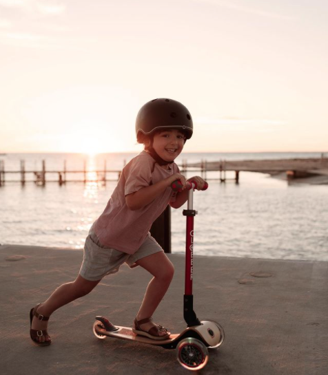Kid on Globber PRIMO FOLDABLE WOOD LIGHTS wooden scooter