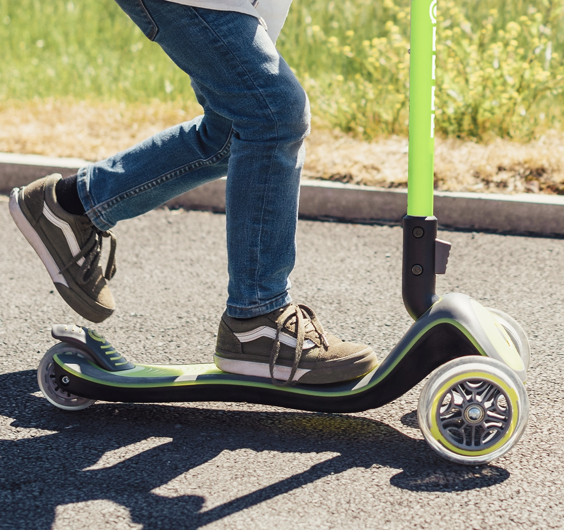 Green light-up scooter for kids with an extra-wide scooter deck